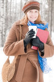 Young woman with books in winter Stock Photography