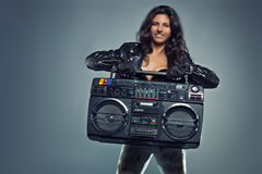 Young woman with boom box Royalty Free Stock Photography