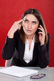 Young woman bored at work Stock Image