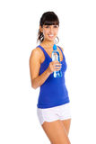 Young woman with bottle in the hand after fitness. Stock Photos