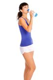 Young woman with bottle in the hand after fitness. Stock Photography