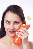 Young woman with a bottle of orange juice Stock Image