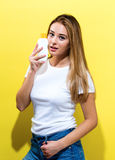 Young woman a bottle of sunblock Royalty Free Stock Images
