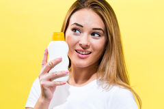 Young woman a bottle of sunblock Royalty Free Stock Photos