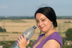 A young woman with a bottle of water. Stock Image