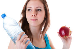 Young woman with bottle of water and apple Stock Images