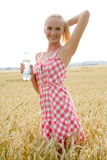 Young woman with bottle of water Royalty Free Stock Images