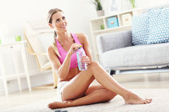 Young woman with bottle of water after workout Stock Photography