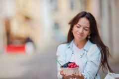 Young woman bought berries in street market. Berries fruits at female hands. Stock Images
