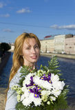 Young woman with bouquet Royalty Free Stock Photos