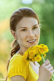 Young woman in with bouquet Stock Photos