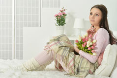 Young woman with bouquet Stock Image