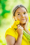 Young woman in with bouquet of dandelions Stock Photos