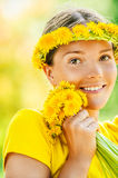 Young woman in with bouquet of dandelions Royalty Free Stock Photos