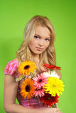 Young woman with a bouquet of flowers Stock Photo