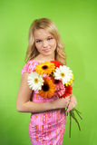Young woman with a bouquet of flowers Royalty Free Stock Photos