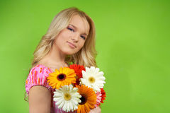 Young woman with a bouquet of flowers Royalty Free Stock Photo