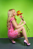 Young woman with a bouquet of flowers Royalty Free Stock Photography