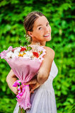 Young woman with bouquet of flowers Royalty Free Stock Photography