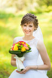 Young woman with bouquet Royalty Free Stock Photo