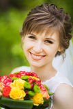 Young woman with bouquet Royalty Free Stock Image