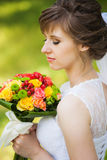 Young woman with bouquet Stock Images