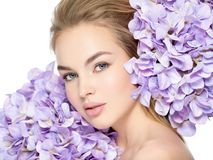Young woman with bouquet of flowers Royalty Free Stock Images