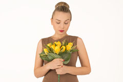Young woman with a bouquet of flowers. Surprised young woman with a bouquet of flowers Stock Photos