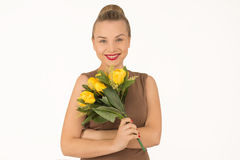 Young woman with a bouquet of flowers. Young woman with bouquet of yellow flowers Royalty Free Stock Photos