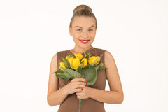 Young woman with a bouquet of flowers. Young woman with bouquet of yellow flowers Royalty Free Stock Photo