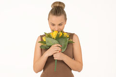Young woman with a bouquet of flowers. Young woman with bouquet of yellow flowers Stock Images