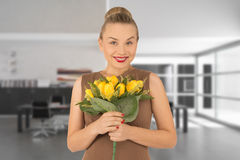 Young woman with a bouquet of flowers. Young woman with a bouquet of yellow flowers Stock Images