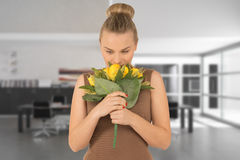 Young woman with a bouquet of flowers Stock Photography