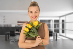 Young woman with a bouquet of flowers. Young woman with a bouquet of yellow flowers Stock Image