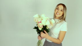 Young woman with bouquet of many roses stock video footage