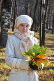 Young woman with a bouquet of maple leaves Royalty Free Stock Image
