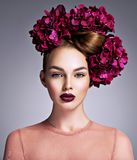 Young woman with a bouquet of purple flowers in her hair. stock photography