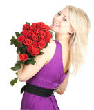 Young woman with a bouquet of red roses Royalty Free Stock Photography