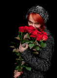 Young woman with a bouquet of red roses Royalty Free Stock Image