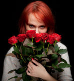 Young woman with a bouquet of red roses Stock Photo