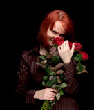 Young woman with a bouquet of red roses Royalty Free Stock Images