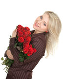 Young woman with a bouquet of red roses Stock Image