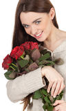Young woman with a bouquet of red roses Royalty Free Stock Photos