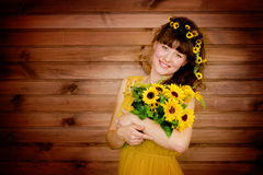 Young woman with a bouquet of sunflowers Royalty Free Stock Photo
