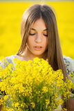 Young woman with a bouquet of yellow wildflowers Royalty Free Stock Images