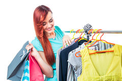Young woman in boutigue with shopping bags Royalty Free Stock Photography