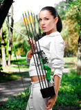 Young woman with a bow and arrows Stock Photos