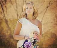 Young woman with bow bouquet Stock Photos