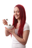 Young woman with bowl of muesli. Young happy woman smiling with a bowl of muesli and berries Royalty Free Stock Photography