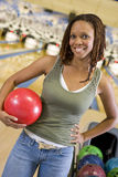 Young woman in a bowling ally Royalty Free Stock Photo